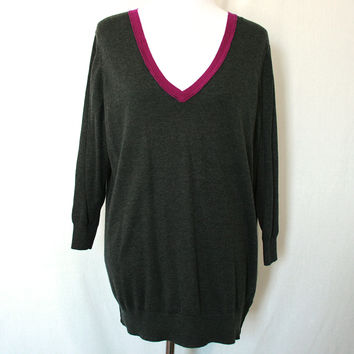 Charcoal gray knit sweater with magenta v-neck collar