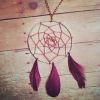 Dreamcatcher necklace with three purple feathers