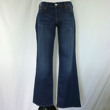 Mid rise stretchy boot cut denim