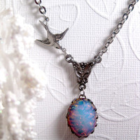 Winter's Blue Fire Opal Necklace With Bird