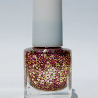 Purple, gold, and silver glitter nail polish