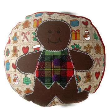 Christmas Pillow featuring a Gingerbread Man appliqued on festive fabric with red piping