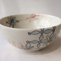 Porcelain bowl, delicate slip trailing with geometric pattern