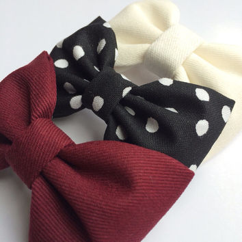 Winter white, black with white dot, and burgundy hair bow set from Seaside Sparrow. These hair bows make a perfect gift for her.