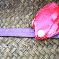 "4 petal Crushed Fuchsia Satin w/ a baby pink pearl in d center on a 3/8"" purple elastic.Baby headband.Photo prop"