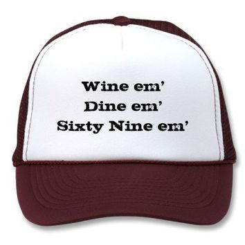 Wine em'Dine em'Sixty Nine em' Trucker Hats from Zazzle.com