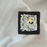 Square black felt brooch with vintage lace and gold butterfly detail