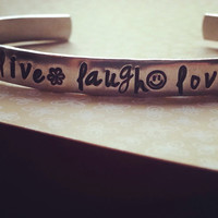 live,  laugh, love bracelet hand stamped with happy face, flower and heart  1/4 inch wide