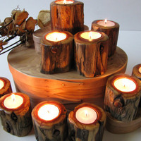 Ten wood tealight candle holders made of juniper.