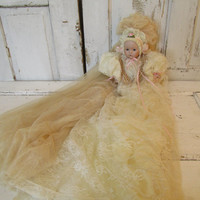 Ornate doll figure draped in antique netting time worn aged shabby chic over sized lace clothing unique headdress home decor anita spero