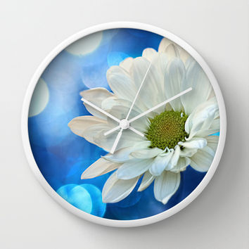 White Daisy on Blue Wall Clock by micklyn