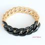 black acrylic and chunky gold bracelet