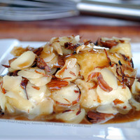 Toasted Almond Bread Pudding with Amaretto-Spiked Brown Butter Caramel Sauce