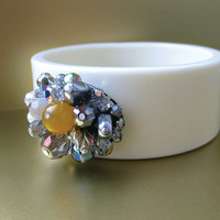Light beige chunky plastic bangle with beautiful Czech glass beads by Karman Jewelry.