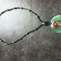 This beautiful beaded necklace is handmade by me. It's a very nice piece for spring and summer.