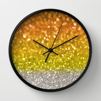 Candy Corn Bokeh Wall Clock by Lisa Argyropoulos | Society6