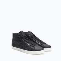 Textured black sneakers