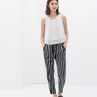 Striped trousers with laces