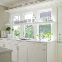 white kitchen with window shelves