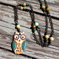 handmade ceramic owl pendant by Kylie Parry on a brass chain with fossil coral and serpentine beads.