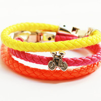 Unisex triple neon bracelet with silver bike bead