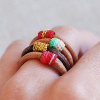 set of 4 leather rings made to your order by kjoo on Etsy