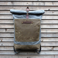 Waxed canvas rucksack/backpack with roll up top and double waxed bottem COLLECTION UNISEX