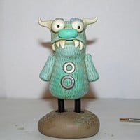 Small steampunk style Sky blue Monster with horns by janell berryman Pumpkinseeds