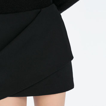 Mini skirt with front pleat