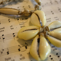 hemp choker necklace with a cowrie shell flower with white and cream beads