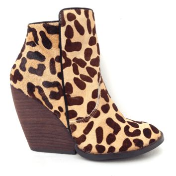Featuring genuine leather upper, real horse-fur bleached and dyed leopard pattern throughout, zipper closure at sides, asymmetrical ankle, almond toe, barrel stack heel, and finish with soft dark plaid patter fabric interior lining.