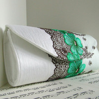 White silk clutch purse with black and green lace overlay. Formal clutch bag
