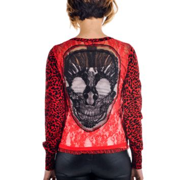 Always fun to wear something unique style with this Lace Skull Applique Back Leopard Cardigan. Featuring leopard print throughout, button up front, soft woven knit fabrication, long sleeves, skull design at semi-sheer lace & mesh back panel, and finish wit