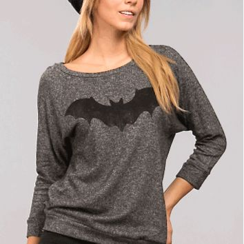 This knit pullover top features a bat silk screen print at front, round neckline, long sleeves, and boxy cut construction.