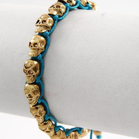 Gold Metal skull bracelet with turquoise cord adjustable