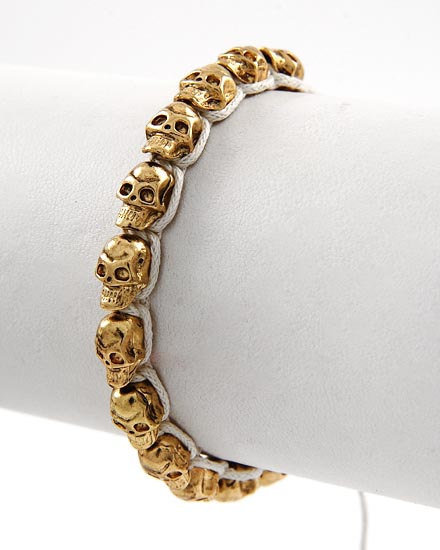 Gold Metal skull bracelet with off white cord adjustable