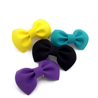 Set of four multicolor bows on barrette clips (yellow, mint, black and purple)
