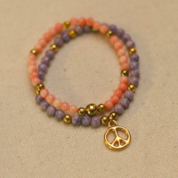 Pink, Gold & Purple Beaded Bracelets: Set of 2 - Beaded Stretch Bracelets in Pink, Gold, and Purple w/ Gold Peace Sign Charm