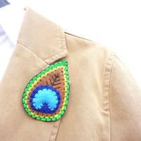 Peacock feather sewn brooch pin