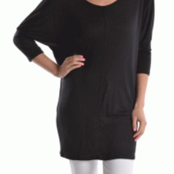 Featuring a wide scoop neckline, three quarter length dolman sleeves, tunic length. Pair with black leatherette leggings, ankle bootie and a jacket.