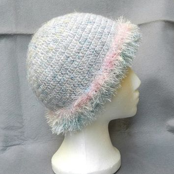 Cute and neat womens white and blue crochet hat with fancy trimming