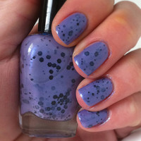 "Nail polish - ""Ursula"" black glitter in a purple base"