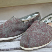 Designs on TOMS shoes.