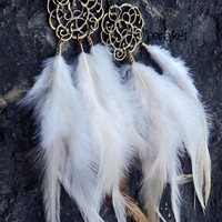 Daydreamer coque feather &amp; antiqued brass earring pair by pareket