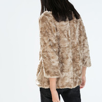 Furry sweater with back zip