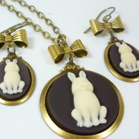 Bunny Rabbit and Bow Cameo Earring & Necklace Set Cream on Brown Background
