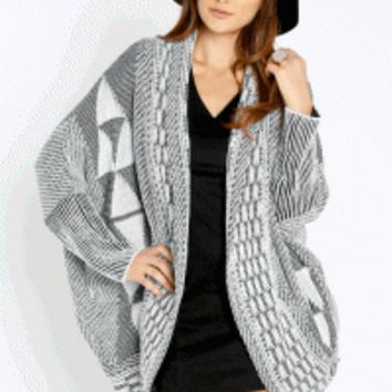 This super soft knit cardigan features an open front, long dolman sleeves, envelope hemline at back, two side of pockets, and chic pattern print throughout. Pair with simple top, waxed skinny jeans, medium size floppy hat and jeffrey Campbell Incharge Shea