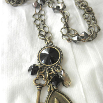 Black and Antique Brass Charm Necklace. Fleur de luis and Key Charm Necklace for Her