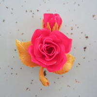 Hot pink and yellow celluloid rose brooch