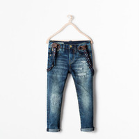 Jeans with skull suspenders